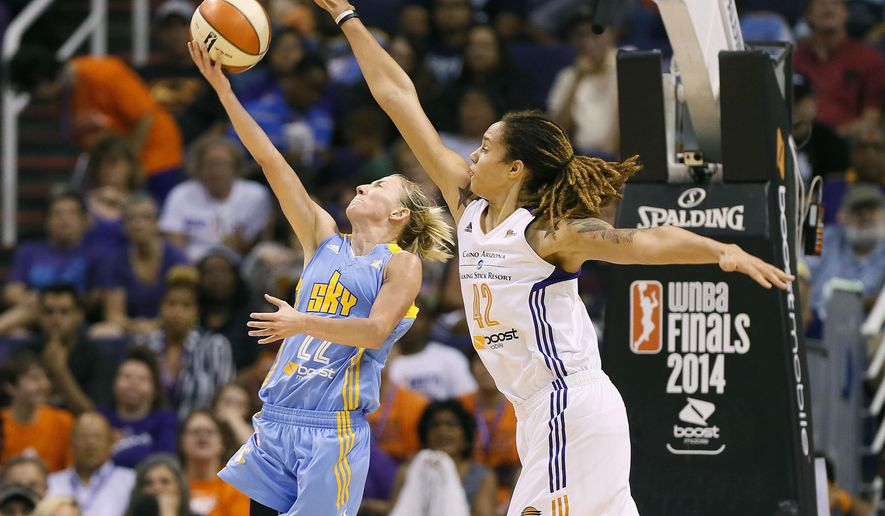 Phoenix Mercury center Brittney Griner (42) blocks the shot of Chicago Sky guard Courtney Vandersloot during the first half of  Game 2 of the WNBA basketball finals, Tuesday, Sept. 9, 2014, in Phoenix. (AP Photo/Matt York)
