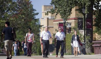 Students and faculty move between classes at Southern Illinois University in Carbondale, Ill., in this Monday, Sept. 8, 2014. (AP Photo/The Southern, Jake Haines)