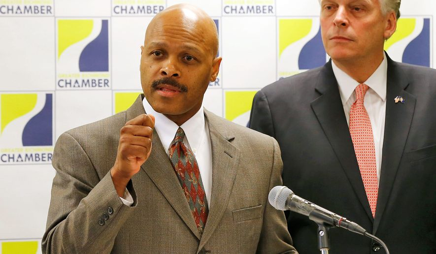 Maurice Jones speaks after Virginia Gov.-elect Terry McAuliffe, right, introduced him as nominee for secretary of commerce and trade at news conference at the Greater Richmond Chamber of Commerce in Richmond Va., Thursday, Jan. 2, 2014.(AP Photo/Richmond Times-Dispatch, Mark Gormus)