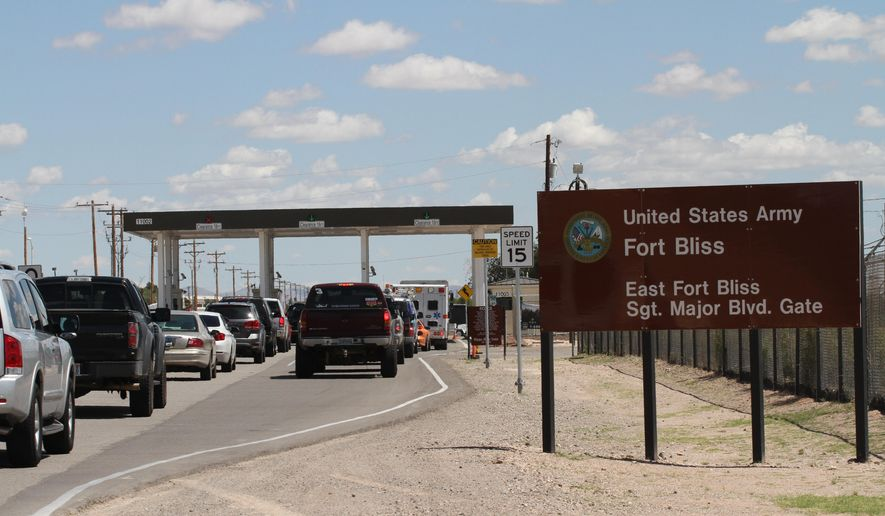 Cars wait to enter Fort Bliss in El Paso, Texas, Tuesday Sept. 9,  2014 in this file photo.  (AP Photo/Juan Carlos Llorca) **FILE**
