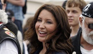In this May 29, 2011 file photo, Bristol Palin, daughter of former GOP vice presidential candidate and Alaska governor Sarah Palin, smiles in Washington. A 25-year-old Florida man is under arrest for stalking Palin in Alaska after inundating her with Facebook messages. (AP Photo/Alex Brandon, File)