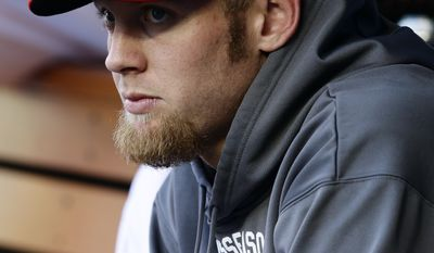 **FILE** Washington Nationals pitcher Stephen Strasburg looks on from the dugout in the sixth inning of Game 3 of the National League division baseball series against the St. Louis Cardinals on Wednesday, Oct. 10, 2012, in Washington. (AP Photo/Alex Brandon)