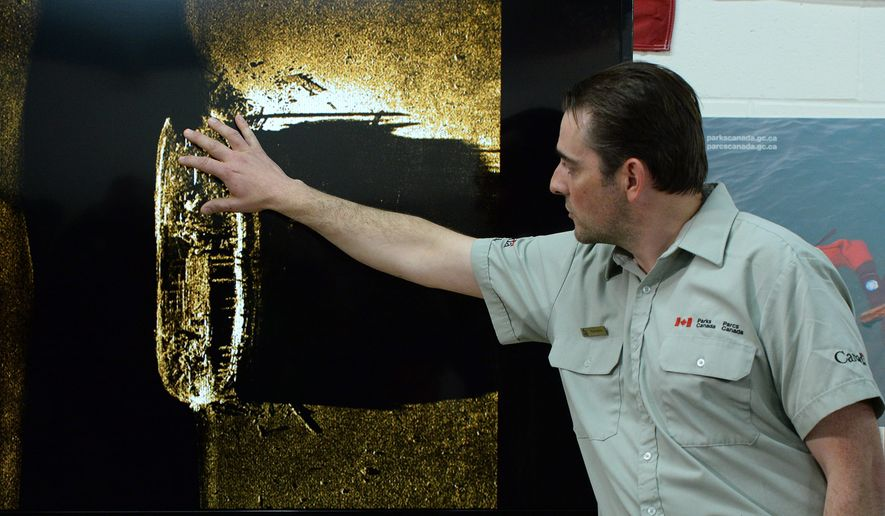 Parks Canada's Ryan Harris explains the find from the Victoria Strait Expedition during a a news conference in Ottawa on Tuesday Sept. 9, 2014. Canadian Prime Minister Stephen Harper announced Tuesday that one of two fabled British explorer ships, the HMS Erebus and HMS Terror, that disappeared in the Arctic more 160 years ago has been found. The ships were last seen in the late 1840s. The Prime Minister said it remains unclear which ship has been found, but images show there's enough information to confirm it's one of the pair.  (AP Photo/The Canadian Press, Sean Kilpatrick)