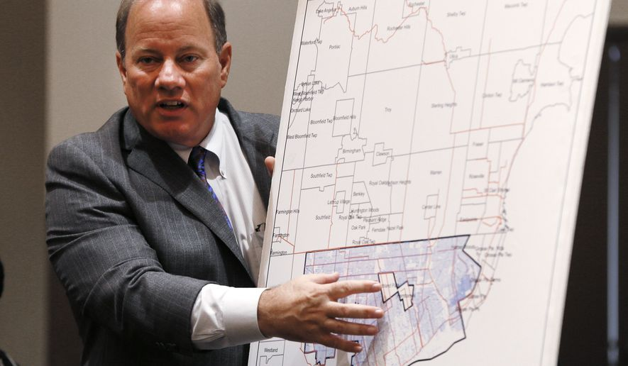 Detroit Mayor Mike Duggan discusses a sewer system map during a news conference in Detroit Tuesday, Sept. 9, 2014. The Detroit water department would be turned into a regional agency with a 10-year limit on rate increases and an infusion of millions of dollars from the suburbs, under a deal announced the mayor and other officials. (AP Photo/Paul Sancya)