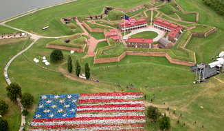 "Almost 7,000 school children assembled at Fort McHenry to form the largest 'living"" American flag on record, to celebrate the 200th anniversary of ""The Star Spangled Banner"". (National Park Service photo)"