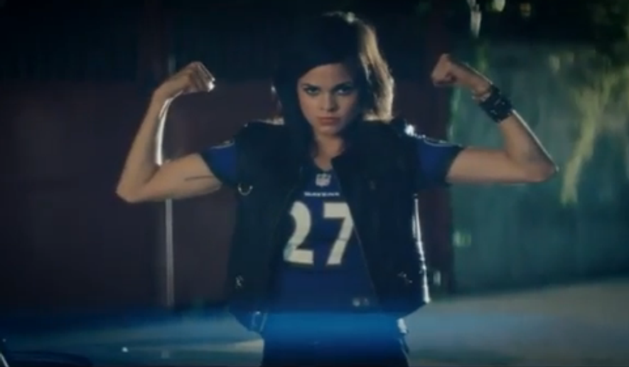 A model wears a Ray Rice jersey in a 2013 NFL commercial for women's apparel. (Screengrab from baltimoreravens.com)