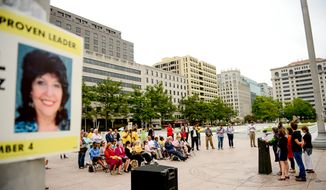A small group of supporters watch as former long time council member Carol Schwartz announces her official campaign for Mayor of Washington, D.C. at Freedom Plaza across from the Wilson Building the day after the Board of Elections certifies that CarolÕs name will be on the ballot, Washington, D.C., Tuesday, September 9, 2014. (Andrew Harnik/The Washington Times)