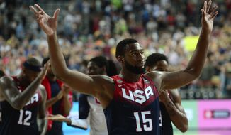 Andre Drummond of the U.S celebrates his team victory against Slovenia in the Basketball World Cup quarterfinal between Slovenia and United States at the Palau Sant Jordi in Barcelona, Spain, Tuesday, Sept. 9, 2014. The 2014 Basketball World Cup competition will take place in various cities in Spain from Aug. 30 through to Sept. 14. (AP Photo/Manu Fernandez)
