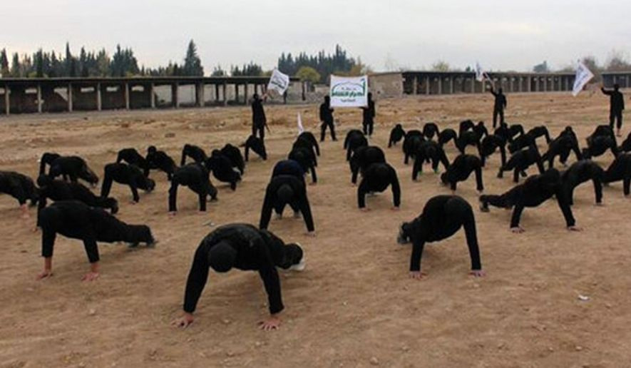 ** FILE ** Syria's Ahrar al-Sham members train at a camp in outside Damascus, December, 2013. (Associated Press)
