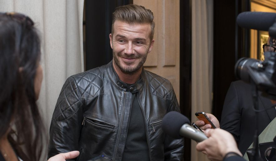 David Beckham is interviewed as he promotes the Beckham for Belstaff collection during Fashion Week, Tuesday, Sept. 9, 2014, in New York. (AP Photo/John Minchillo) ** FILE **