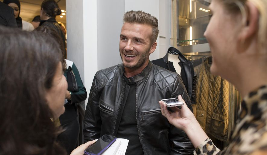 David Beckham is interviewed as he promotes the Beckham for Belstaff collection during Fashion Week, Tuesday, Sept. 9, 2014, in New York. (AP Photo/John Minchillo)