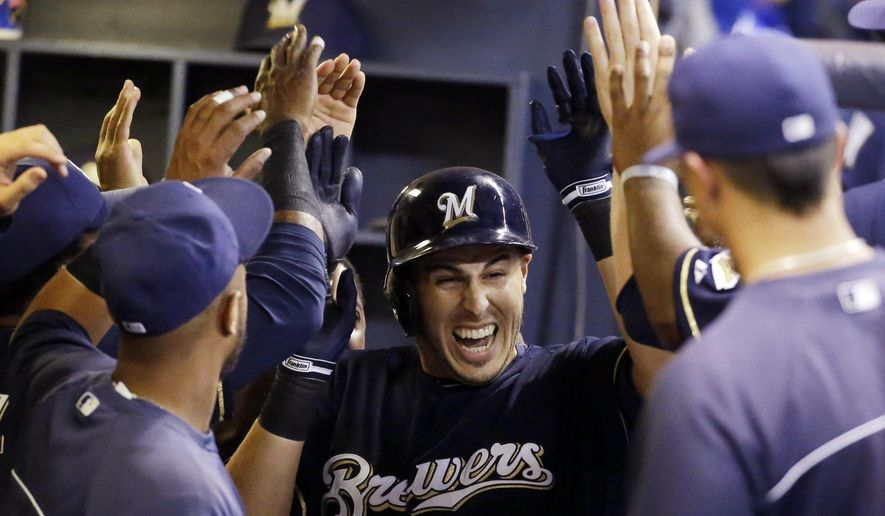 Milwaukee Brewers' Matt Clark is congratulated by teammates after hitting his first home run in the majors, during the seventh inning of a baseball game against the Miami Marlins on Wednesday, Sept. 10, 2014, in Milwaukee. (AP Photo/Morry Gash)