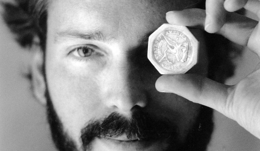 ADVANCE FOR USE SUNDAY, SEPT. 14, 2014, AND THEREAFTER-  In this November 1989 photo, Tommy Thompson holds a $ 50 pioneer gold piece retrieved earlier in 1989 from the wreck of the gold ship Central America. Thompson led a group that recovered millions of dollars worth of sunken treasure only to end up involved in court cases brought by dozens of insurance companies laying claim to the treasure. (AP Photo/The Columbus Dispatch, Lon Horwedel)