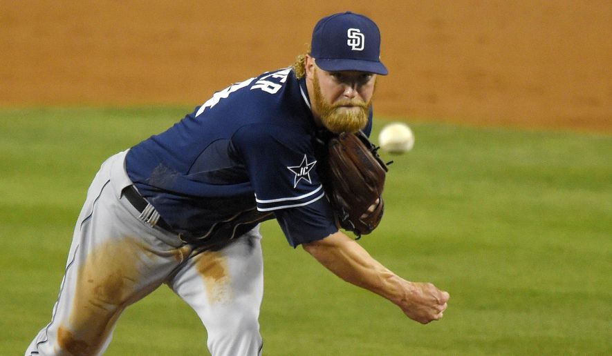San Diego Padres starting pitcher Andrew Cashner throws to the plate during the second inning of a baseball game against the Los Angeles Dodgers, Tuesday, Sept. 9, 2014, in Los Angeles. (AP Photo/Mark J. Terrill)