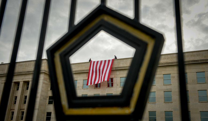 A large American Flag is unfurled on the Pentagon a day before the anniversary of the 9/11 attacks, Arlington, Va., Wednesday, September 10, 2014. (Andrew Harnik/The Washington Times)