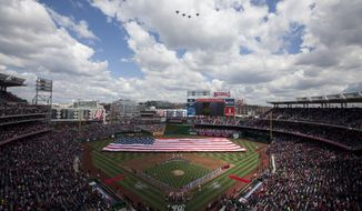 Jets fly over Nationals Park before the start of an opening day baseball game between the Cincinnati Reds and Washington Nationals on Thursday, April 12, 2012 in Washington.  (AP Photo/Evan Vucci)