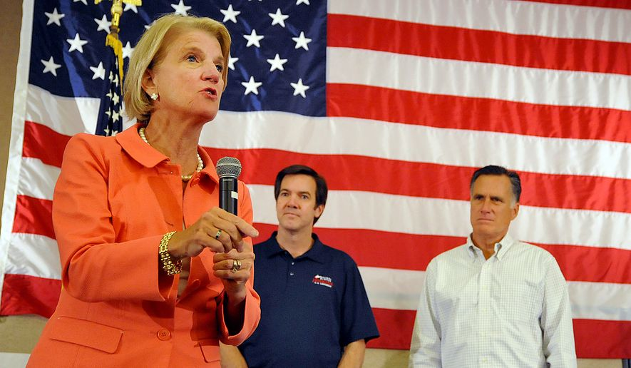 **FILE** Rep. Shelley Moore Capito as speaks at Tamarack during the Working for Jobs Rally in Beckley, W.Va., on Aug. 19, 2014. Looking on are Sen. Evan Jenkins and Former Massachusetts Gov. Mitt Romney. (Associated Press)