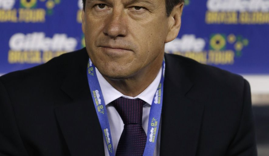 Brazil coach Dunga sits on the bench before an international soccer friendly between Ecuador and Brazil, Tuesday, Sept. 9, 2014, in East Rutherford, N.J. (AP Photo/Julio Cortez)