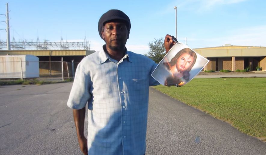 The #BurnWhiteJesus campaign is gaining steam on social media in which non-white participants are asked to set fire to photos of Jesus Christ. (YouTube/Mrsavannahblack)