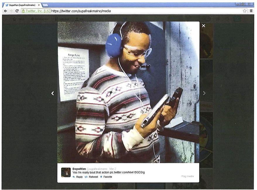 In this undated image released by the U.S. Attorney's Office in Boston, Kwmaine Davis holds a firearm in a photo he posted on Twitter. Davis was sentenced Wednesday, Sept. 10, 2014, to 18 months in prison for being a convicted felon in possession of a firearm. (AP Photo/U.S. Attorney's Office)