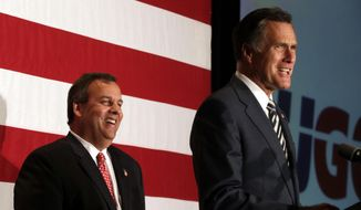 New Jersey Gov. Chris Christie, left, laughs while former Republican presidential contender Mitt Romney speaks at an event celebrating Christie's 52nd birthday, Wednesday, Sept. 10, 2014, in East Brunkswick, N.J. (AP Photo/Julio Cortez)