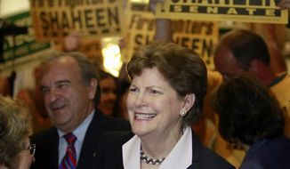 FILE - In this June 9, 2014 file photo, Sen. Jeanne Shaheen D-N.H. is surrounded by supporters in Concord, N.H. to file her campaign paperwork to seek re-election. Shaheen is wasting no time contrasting Republican Scott Brown's recent arrival in New Hampshire to her deep connections and decades of service. (AP Photo/Jim Cole, File)