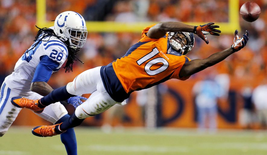 10ThingstoSeeSports - Denver Broncos wide receiver Emmanuel Sanders (10) can't make the catch as Indianapolis Colts cornerback Greg Toler (28) defends during the second half of an NFL football game, Sunday, Sept. 7, 2014, in Denver. The Broncos won 31-24. (AP Photo/Joe Mahoney, File)