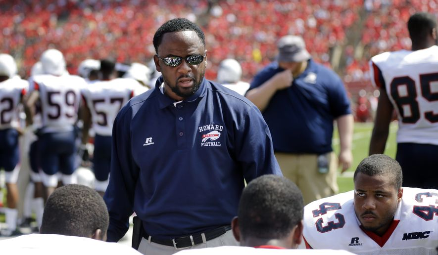 Howard head coach Gary Harrell talks to his players on the sidelines during the first half of an NCAA college football game against Rutgers Saturday, Sept. 6, 2014, in Piscataway, N.J. Rutgers won 38-25. (AP Photo/Mel Evans)