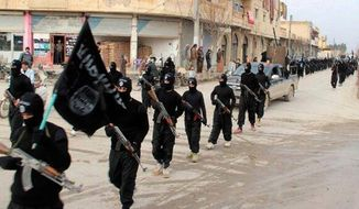 ** FILE ** This undated file image posted on a militant website on Jan. 14, 2014, which has been verified and is consistent with other AP reporting, shows fighters from the al Qaeda-linked Islamic State of Iraq and the Levant (ISIL) marching in Raqqa, Syria. (AP Photo/Militant Website, File)