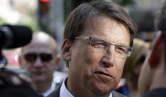 Gov. Pat McCrory speaks to members of the media following an appearance at a NASCAR Bank of America 500 Trophy Tour event in downtown Raleigh, N.C., Wednesday, Sept. 10, 2014. (AP Photo/Gerry Broome)