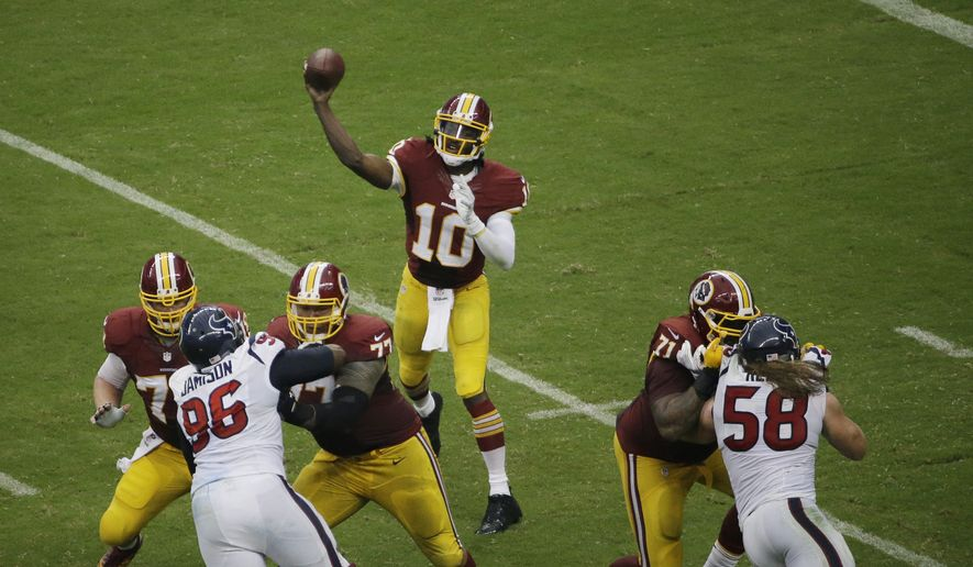 Washington Redskins quarterback Robert Griffin III (10) makes a pass during the third quarter of an NFL football game Sunday, Sept. 7, 2014, in Houston. (AP Photo/David J. Phillip)
