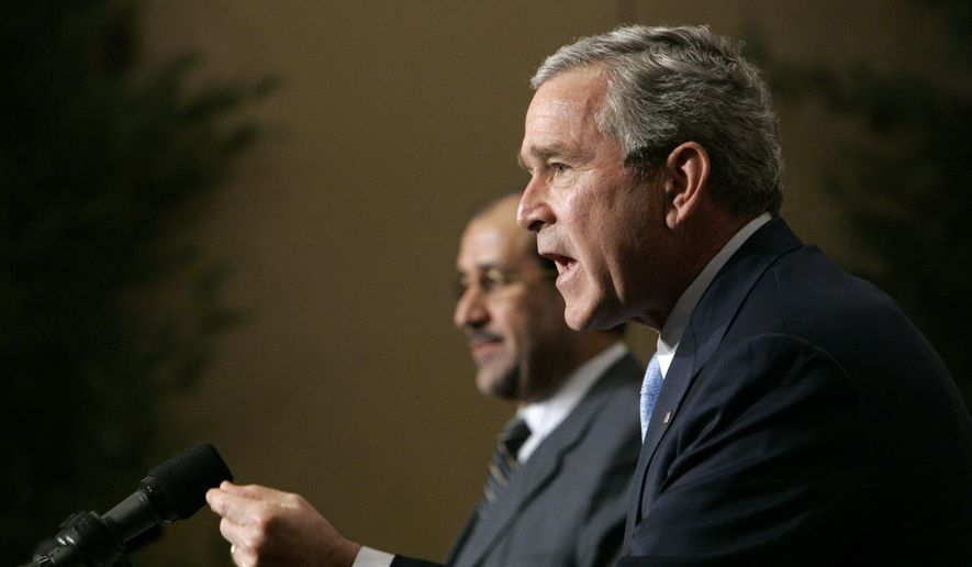 FILE - In this Thursday, Nov. 30, 2006 file photo, U.S. President George W. Bush speaks during a joint press conference with Iraqi Prime Minister Nouri al-Maliki in Amman, Jordan. Ibrahim Hooper, spokesman for the Washington-based Council on American-Islamic Relations, says the Islamic State group's ascension in Iraq could have been prevented if the U.S. had insisted on a nonsectarian Iraqi government, rather than the one led by the recently replaced al-Maliki that favored Shiite Muslims over the Sunnis. (AP Photo/Pablo Martinez Monsivais)