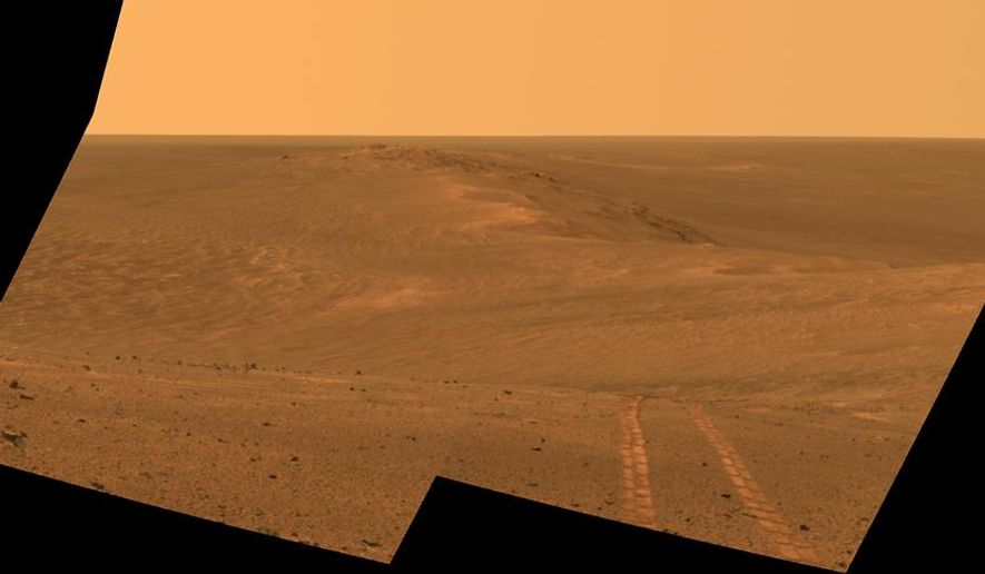 This Aug. 15, 2014, composite image released by NASA and made by NASA's Mars Exploration Rover Opportunity, shows a view looking back toward part of the west rim of Endeavour Crater that the rover drove along, heading southward, during the summer of 2014. NASA announced Thursday, Sept. 11, 2014, that the rover has reached the base of Mount Sharp, its long-term science destination since landing two years ago. Officials say drilling could begin as early as next week at an outcrop of rocks called Pahrump Hills. (AP Photo/NASA, JPL-Caltech, Cornell University, Arizona State University)