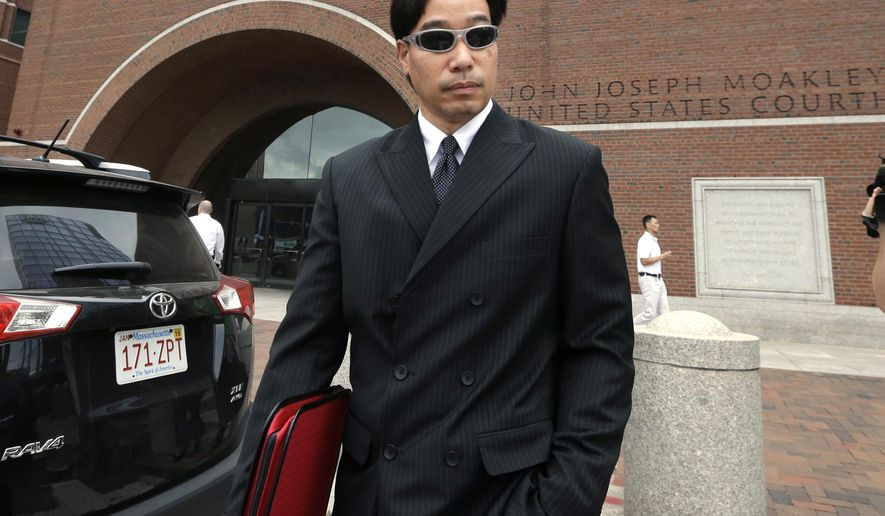 Glenn Adam Chin, former supervisory pharmacist at the New England Compounding Center, departs federal court, Thursday, Sept. 11, 2014, in Boston. Prosecutors say Chin oversaw the sterile clean rooms at the New England Compounding Center in Framingham, Mass., which custom-mixed medications in bulk and where tainted steroids blamed for the 2012 outbreak were made. (AP Photo/Steven Senne)