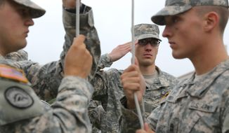 Members of Western Michigan University's ROTC Army and Air Force salute as the American flag hoisted to fly at half-staff during a remembrance ceremony honoring the victims of the Sept. 11 terrorist attacks Thursday, Sept. 11, 2014, in Kalamazoo, Mich. (AP Photo/Kalamazoo Gazette-MLive Media Group, Mark Bugnaski) ** FILE **