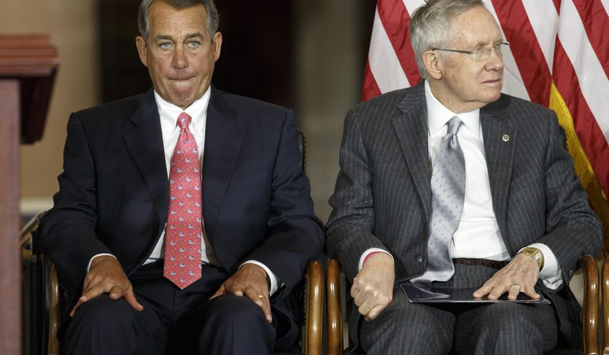 """In this Sept. 10, 2014, photo, House Speaker John Boehner of Ohio, left, sits with Senate Majority Leader Harry Reid of Nev., on Capitol Hill in Washington, as Congress honored victims of the terror attacks of September 11, 2001, during a """"Fallen Heroes of 9/11 Gold Medal Ceremony."""" The House and Senate are controlled by different political parties, but both are spending time these days on similar paths: debating measures that everyone knows are going nowhere.  (AP Photo/J. Scott Applewhite)"""