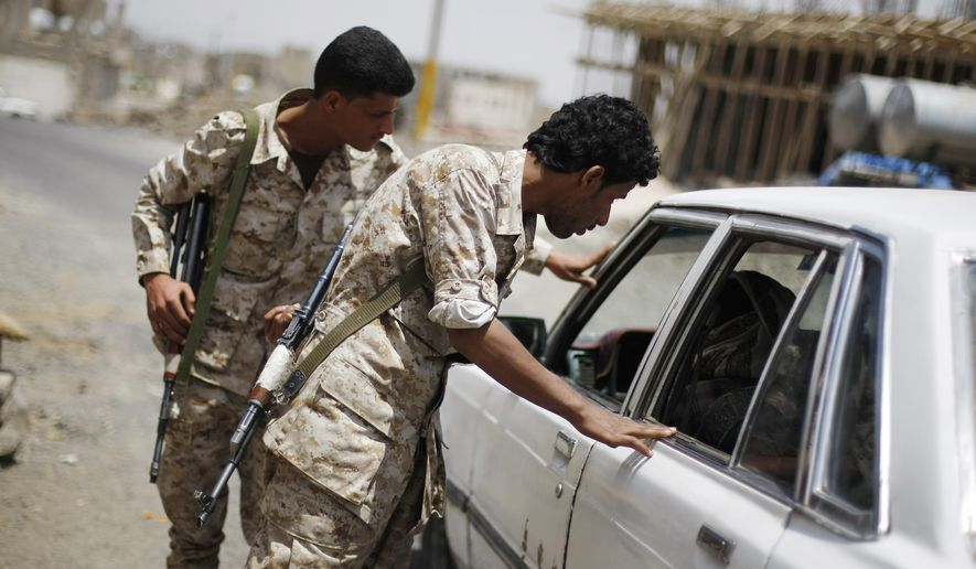 Yemeni army soldiers check a car at a checkpoint while guarding the entrance of Sanaa, Yemen, Wednesday, Sept. 10, 2014. Tensions have been escalating in the Yemeni capital, where the Hawthis have staged weekslong anti-government demonstrations, often clashing with the police forces and demanding that the government reinstate fuel subsidies and then resign. (AP Photo/Hani Mohammed)