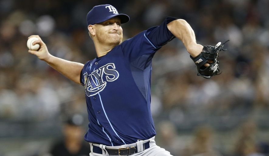 Tampa Bay Rays starting pitcher Alex Cobb delivers in the sixth inning of a baseball game against the New York Yankees at Yankee Stadium in New York, Thursday, Sept. 11, 2014. (AP Photo/Kathy Willens)
