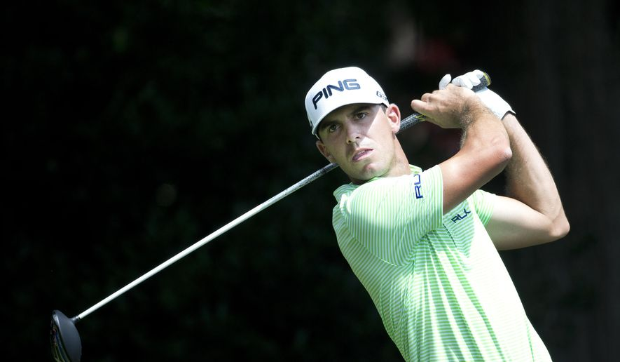 Bily Horschel hits from the tee on the third hole during first round of play in the Tour Championship golf tournament  Thursday, Sept. 11, 2014, in Atlanta. (AP Photo/John Bazemore)