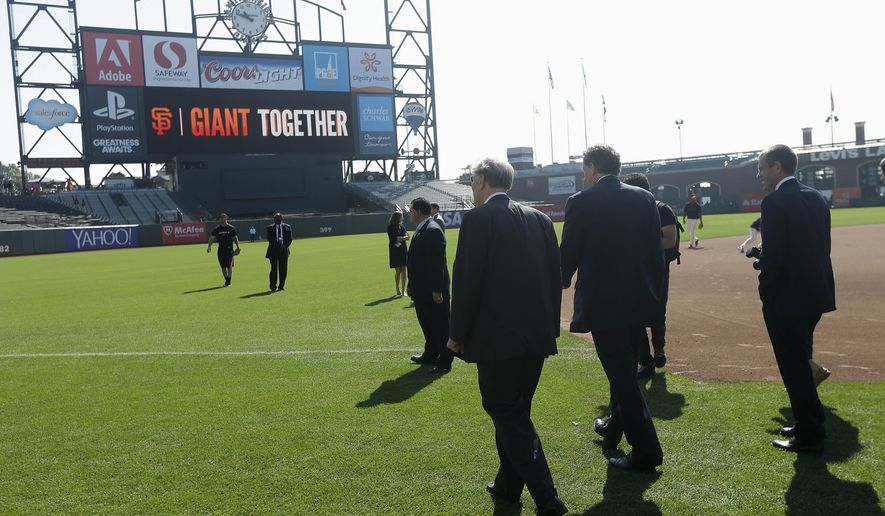Major League Baseball commissioner Bud Selig, center, tours AT&T Park with San Francisco Giants owner Larry Baer, center right, and executives before a baseball game between the Giants and the Arizona Diamondbacks in San Francisco, Thursday, Sept. 11, 2014. (AP Photo/Jeff Chiu)