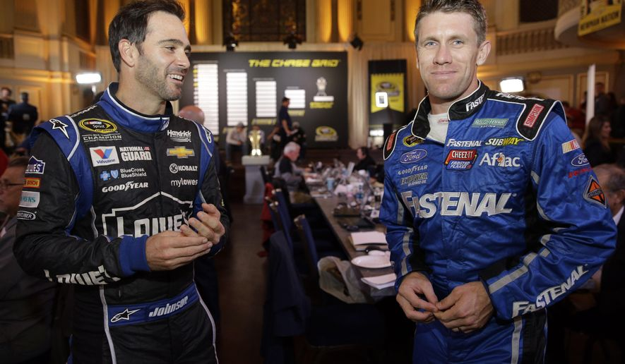 Jimmie Johnson, left, and Carl Edwards chat during the NASCAR Sprint Cup media day in Chicago, Thursday, Sept. 11, 2014. The 16 drivers in the Chase for the Sprint Cup championship took part in the event. The opening race in the Chase is at Chicagoland Speedway on Sunday in Joliet, Ill. (AP Photo/Nam Y. Huh)