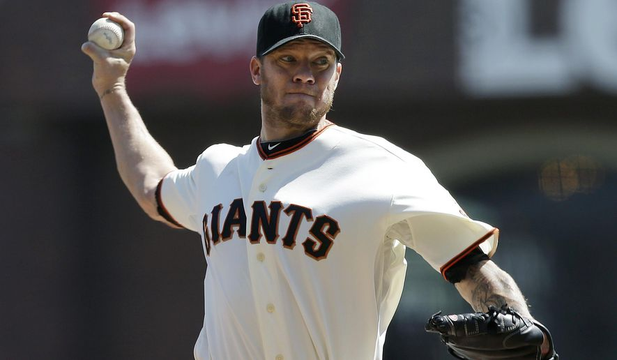 San Francisco Giants pitcher Jake Peavy throws against the Arizona Diamondbacks during the second inning of a baseball game in San Francisco, Thursday, Sept. 11, 2014. (AP Photo/Jeff Chiu)
