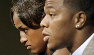Janay Rice, left, looks on as her husband, Baltimore Ravens running back Ray Rice, speaks to the media during a news conference in Owings Mills, Md., in this May 23, 2014, file photo. (AP Photo/Patrick Semansky, File)