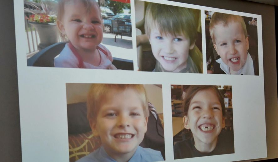 Photos of Timothy Ray Jones Jr. children are on display during a news conference at the Lexington County Sheriff's Dept Training Center in Lexington, S.C., Wednesday, Sept. 10, 2014.  Jones Jr., 32, will be charged with murder in the deaths of his five children after he led authorities to a secluded clearing in Alabama, where their bodies were found wrapped in garbage bags, a sheriff said Wednesday.  (AP Photo/ Richard Shiro)