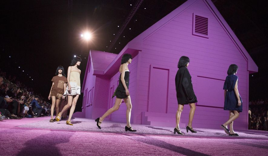 The Marc Jacobs Spring 2015 collection is modeled during Fashion Week, Thursday, Sept. 11, 2014, in New York. (AP Photo/John Minchillo)
