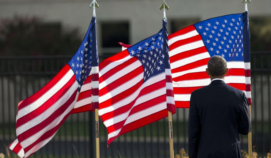 President Barack Obama faces towards the Pentagon, Thursday, Sept. 11, 2014, during an observance ceremony to mark the 13th anniversary of the 9/11 attacks. (AP Photo/Pablo Martinez Monsivais)