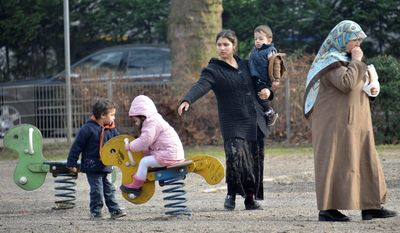 emigres: Children play at a Turkish neighborhood in Duisburg, Germany. The country needs immigrants to replace retiring workers, particularly those with college degrees. (Associated Press)