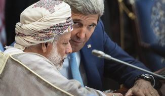 Oman's Foreign Minister Yusuf bin Alawi bin Abdullah (left) and Secretary of State John F. Kerry at met with Mideast allies and asked what support they can to give to the U.S. plan to combat the Islamic State group. (Associated Press)