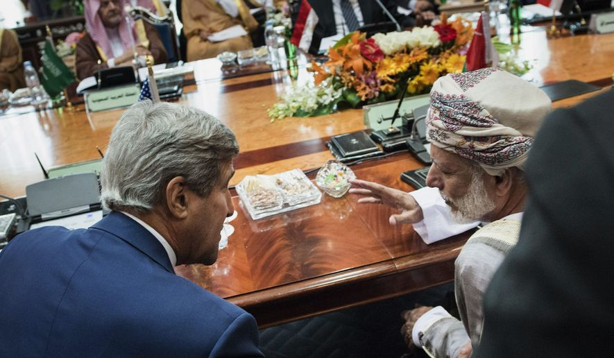 Oman Foreign Minister Yusuf bin Alawi bin Abdullah and U.S. Secretary of State John F. Kerry talk before a meeting of the Gulf Arab region in Jiddah, Saudi Arabia, Thursday. Mr. Kerry sought to pin down Middle Eastern allies on what support they are willing to give to the new U.S. plan to beat back the Islamic State militant group. (Associated Press)