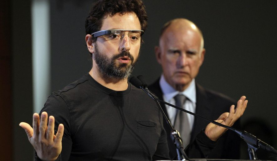 FILE - In this Sept. 25, 2012 file photo, Google co-founder Sergey Brin, left, wearing Google Glass, speaks as California Gov. Jerry Brown, right, listens during a bill signing for driverless cars at Google headquarters in Mountain View, Calif. Despite Brin's and other tech entrepreneurs' frustration with the complex web of federal rules governing health care, their industry continues pouring money into efforts to reshape the $2.7 trillion dollar sector that has been largely untouched by the innovations of Silicon Valley. (AP Photo/Eric Risberg, File)